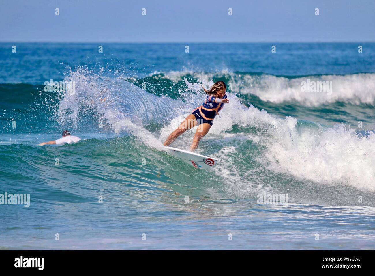 Professional French surfer Pauline Ado surfing off the coast of Huntington Beach, California Stock Photo