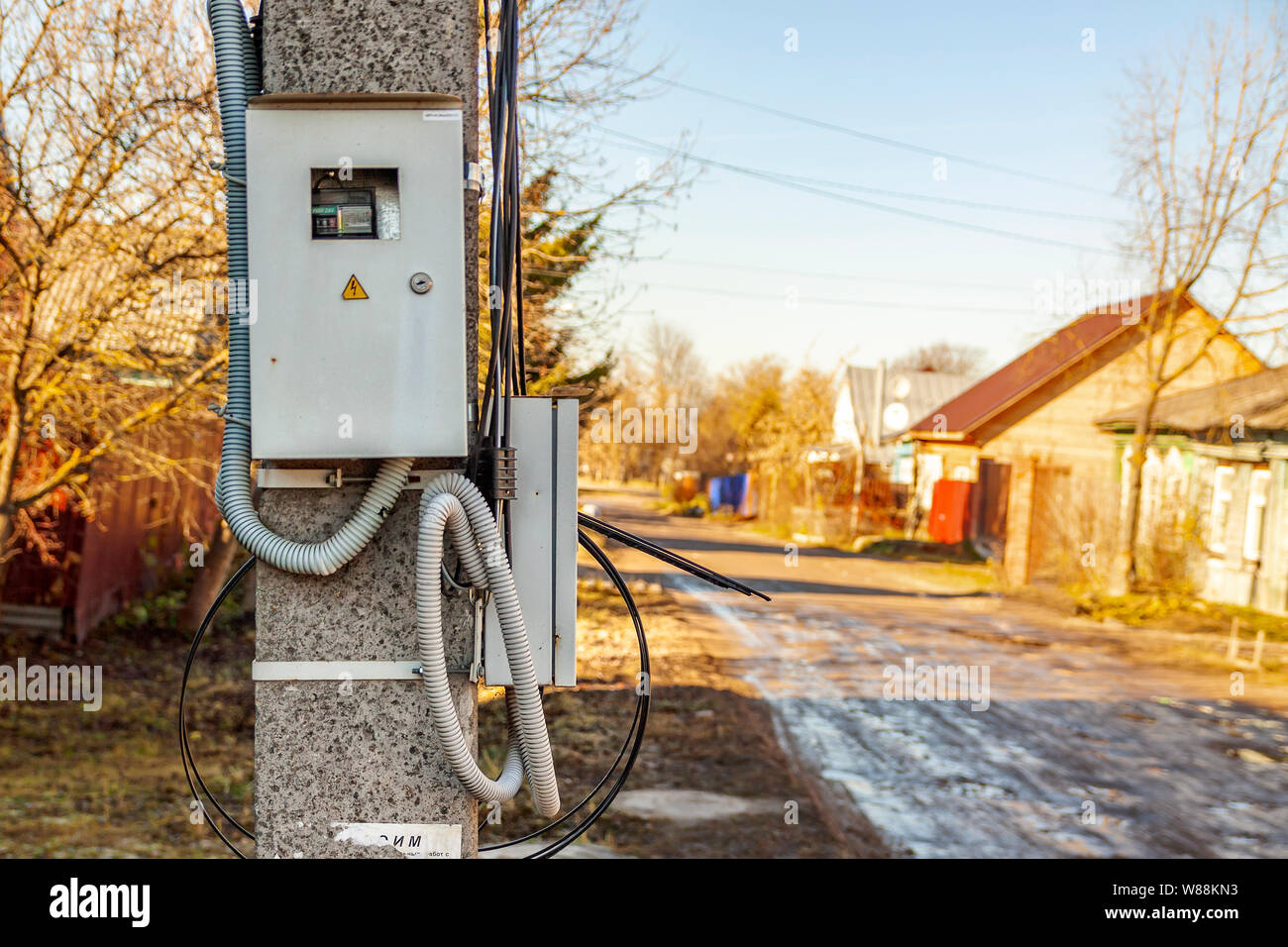 Power cabinet hanging on a pole in the village Stock Photo