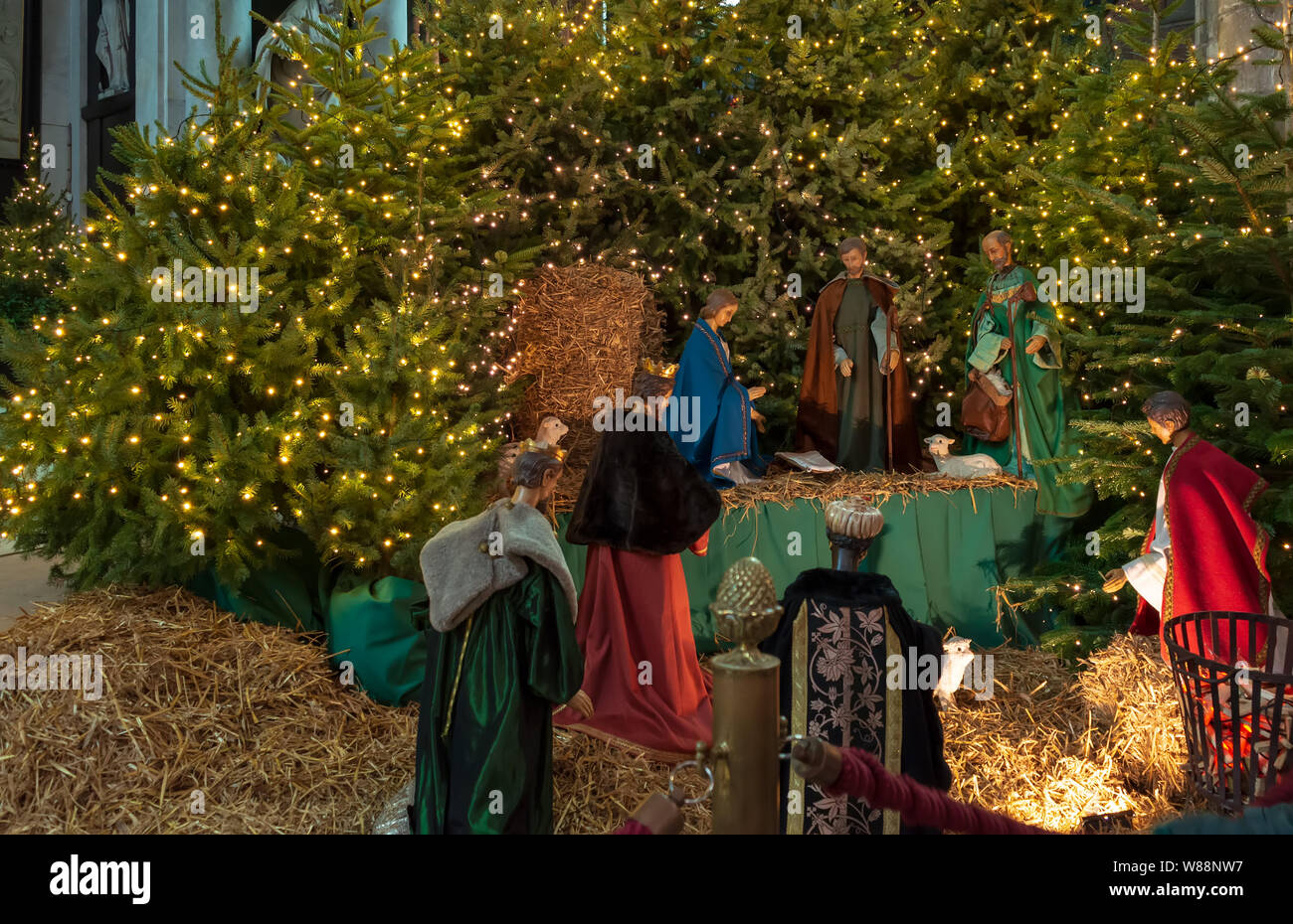 Ghent, Belgium - December 16, 2018: Nativity scene exhibit figures representing the birth of Jesus at Christmas season in Saint Bavo Cathedral. Stock Photo
