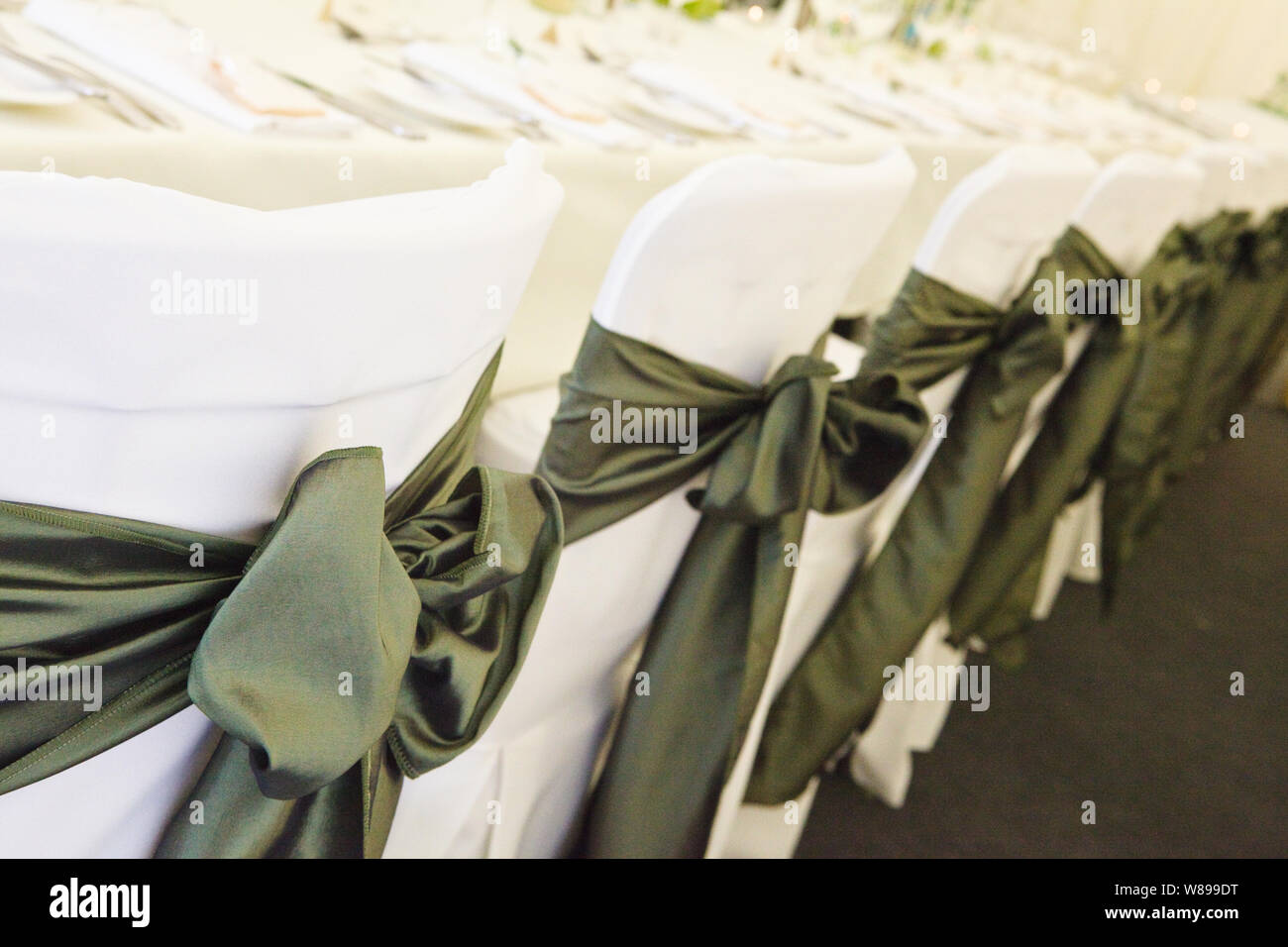 Swell White Wedding Chair Covers With Green Satin Bows Stock Photo Inzonedesignstudio Interior Chair Design Inzonedesignstudiocom