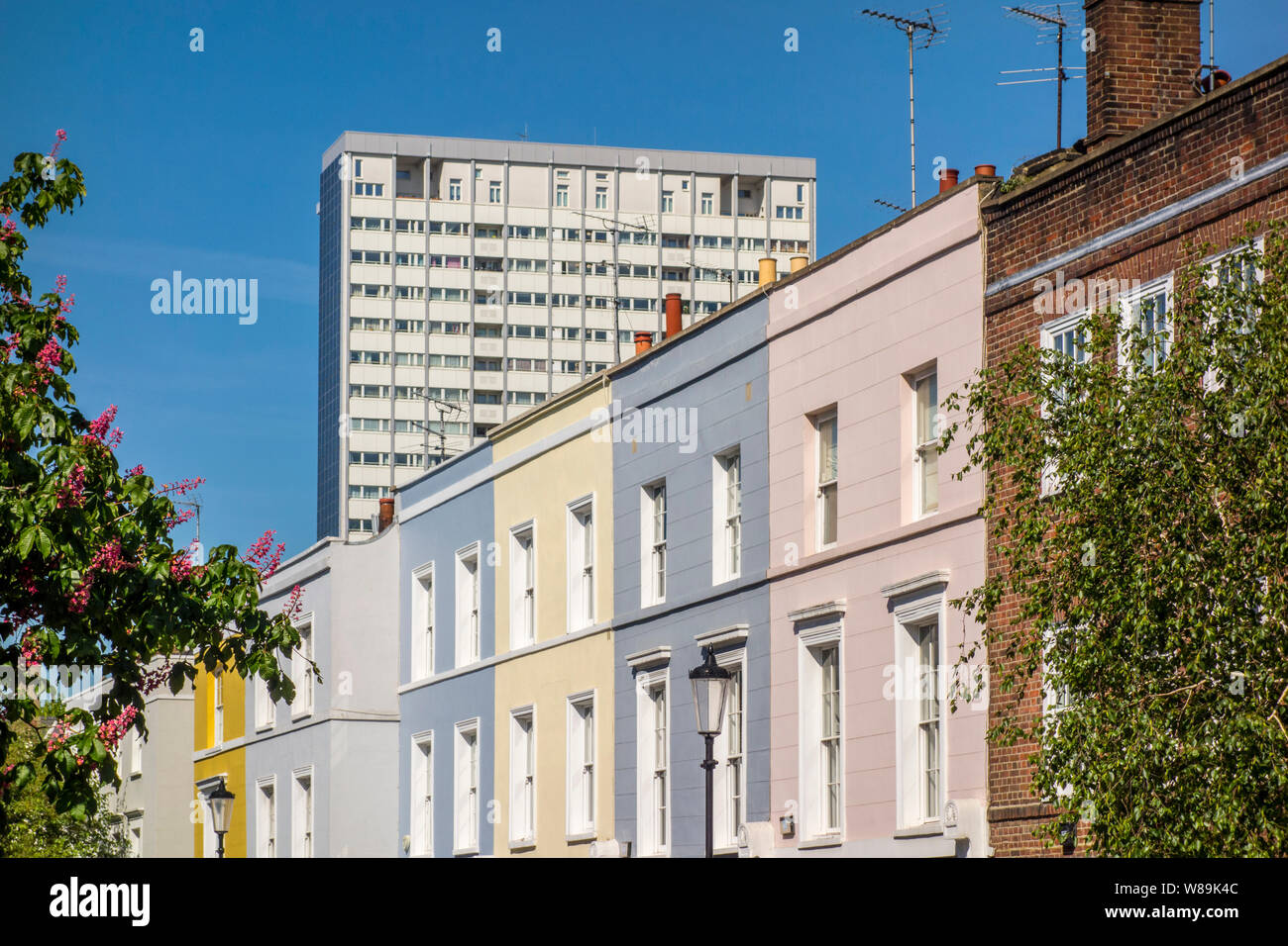 Poynter House high rise tower block behind expensive Notting Hill house houses, Kensington and Chelsea, London, UK Stock Photo