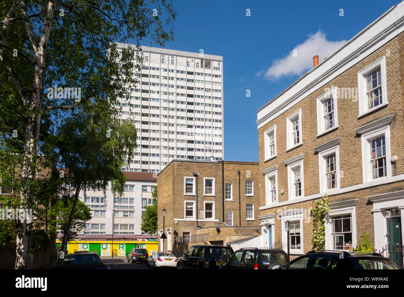 Tower block overlooking Georgian terraced houses on St. James's Gardens, The Royal Borough of Kensington and Chelsea, Notting Hill, London, UK Stock Photo