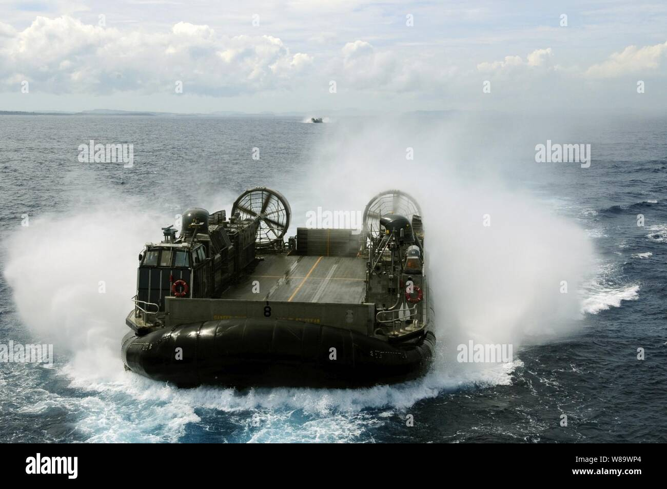 A landing craft air cushioned, also known as an LCAC, assigned to Assault Craft Unit 5, enters the well deck of the dock landing ship USS Harpers Ferry (LSD 49) on June 23, 2008.  The Harpers Ferry is part of the Essex Expeditionary Strike Group forward deployed to Sasebo, Japan. Stock Photo
