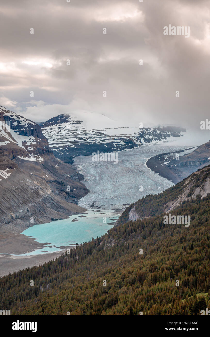 The ice at Parker Ridge Glacier slowly melts into the lake below. Stock Photo