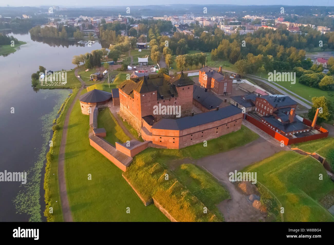 Ancient fortress in a cityscape in the early July morning (aerial photography). Hameenlinna, Finland Stock Photo