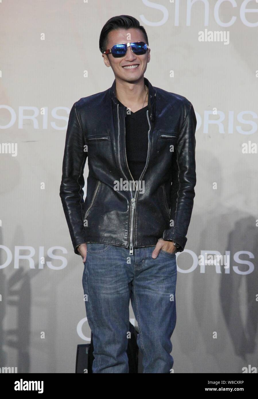 Hong Kong singer and actor Nicholas Tse smiles at a promotional event for Swiss watch brand ORIS in Shanghai, China, 20 September 2015. Stock Photo