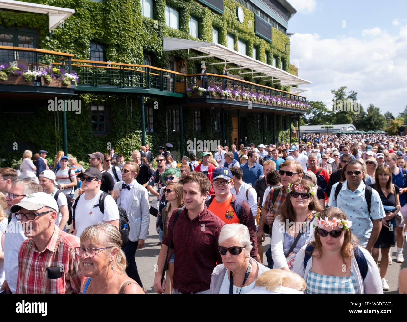 Crowd coming into the ground  during 2019 Wimbledon Championships, London, England, United Kingdom Stock Photo