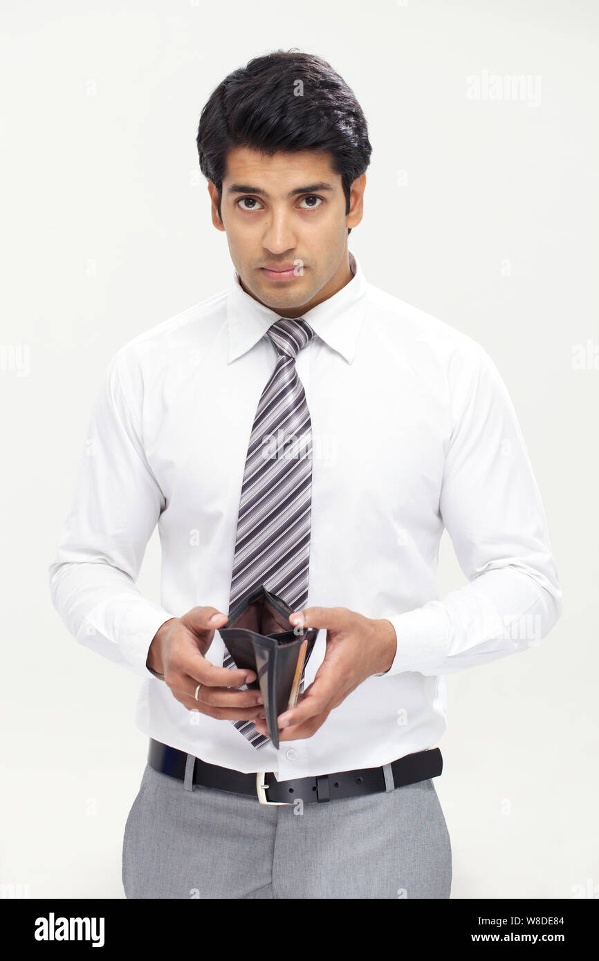 Businessman holding empty wallet Stock Photo