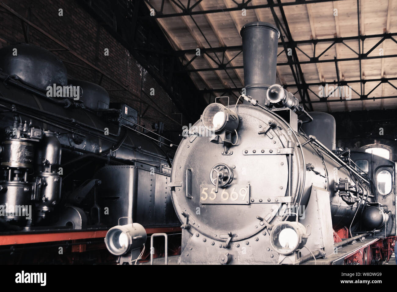 Old steam locomotives in a roundhouse in Germany Stock Photo
