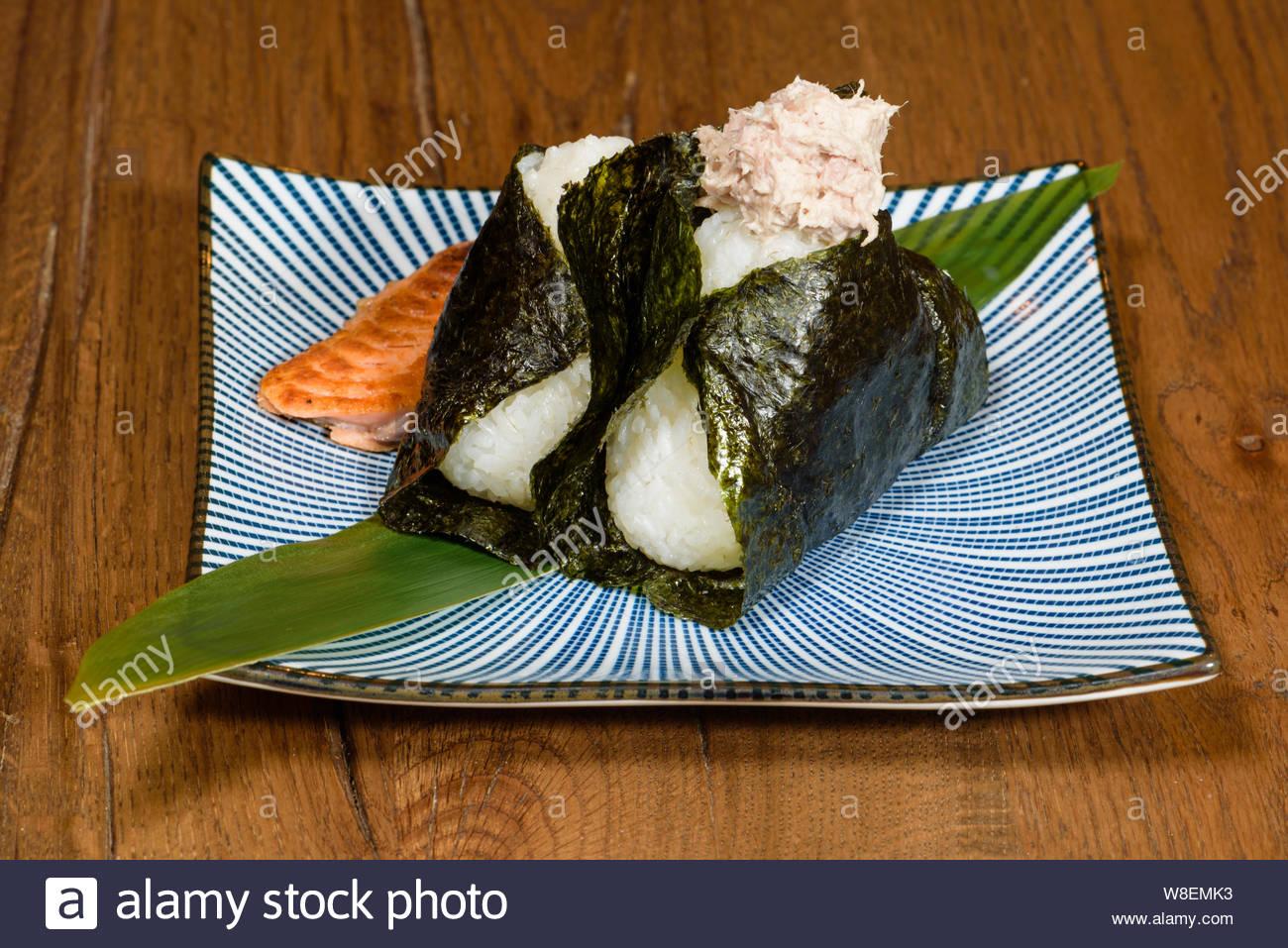 onigiri of roasted tuna and salmon, wrapped in seaweed, darl