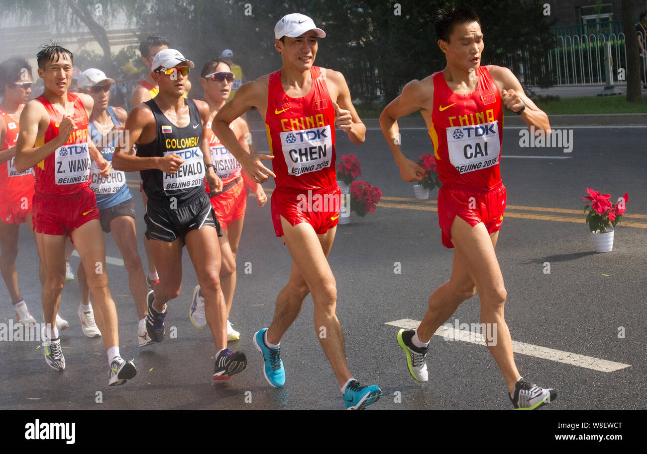 Athletes compete in the men's 20km Walk during the Beijing 2015 IAAF World Championships in Beijing, China, 23 August 2015. Stock Photo