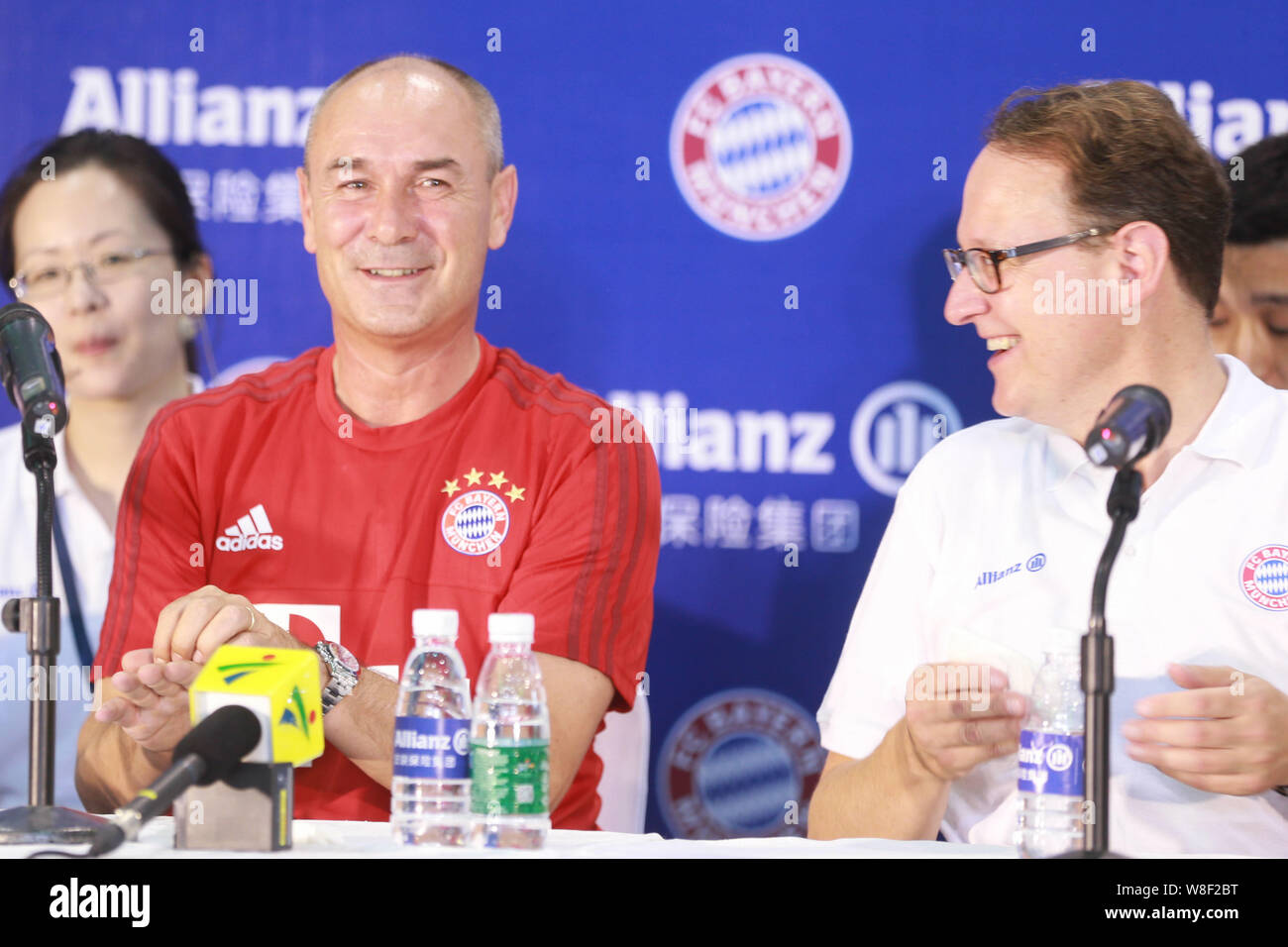 Former German soccer star Raimond Aumann, left, smiles during a fan meeting event in Guangzhou city, south China's Guangdong province, 23 July 2015. Stock Photo