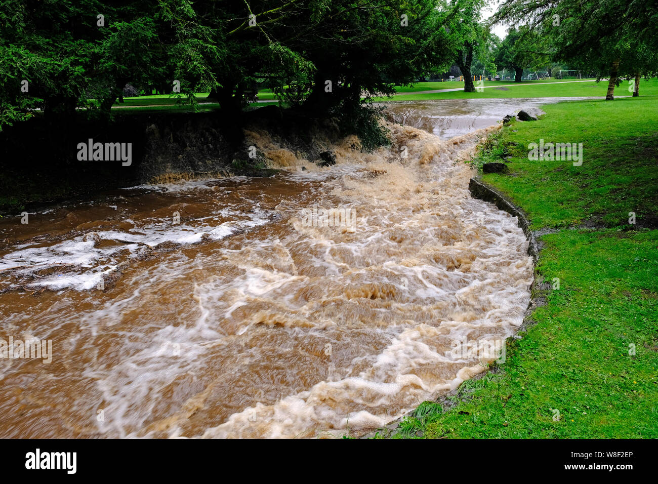 The River Wye in Buxton swollen with floodwater after heavy summer rain Stock Photo