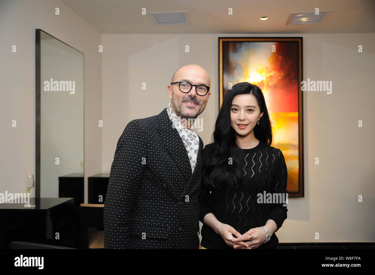 Chinese actress Fan Bingbing (right) poses with executive of Rossano Ferretti during the opening ceremony for a new store of Rossano Ferretti Hair Spa Stock Photo
