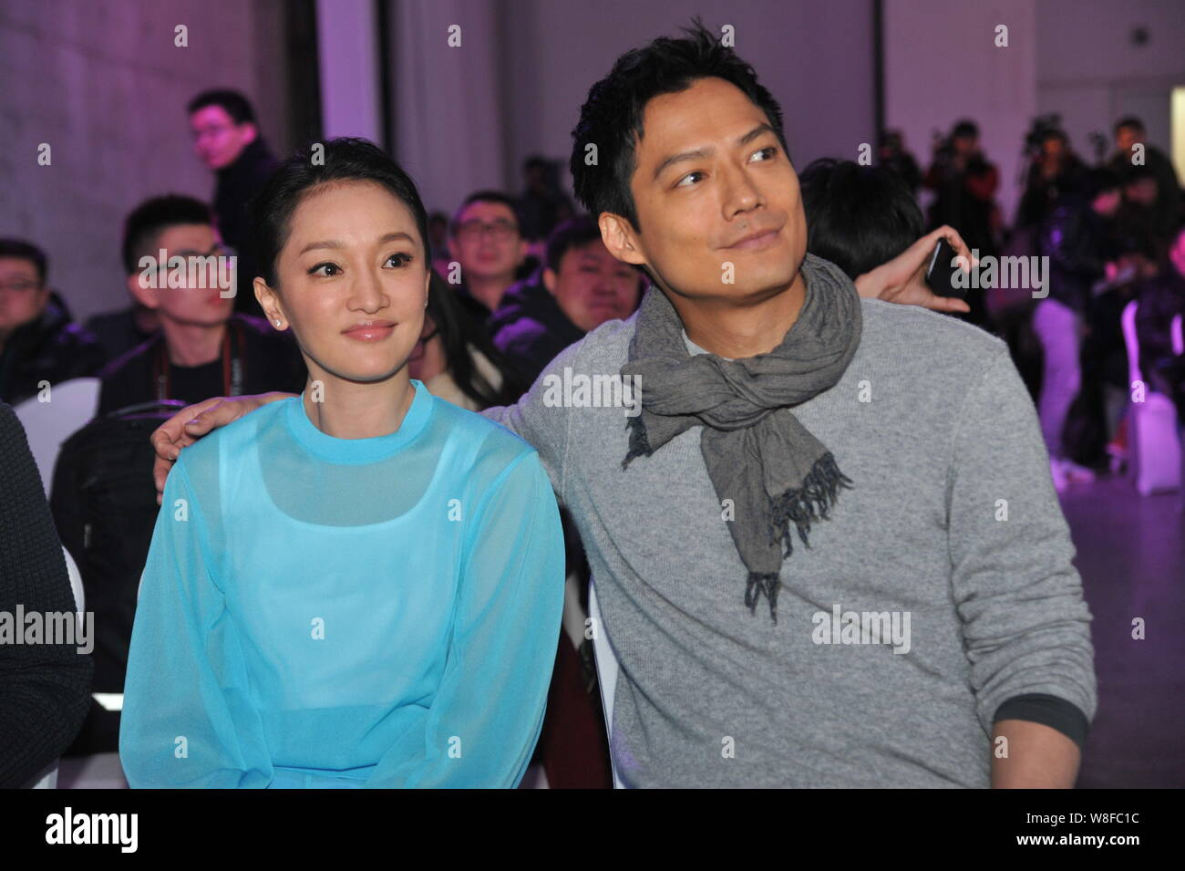 """Chinese actress Zhou Xun, front, and her American actor husband Archie Kao attend a premiere event for the micro film """"Dream Escape"""" to promote Infini Stock Photo"""