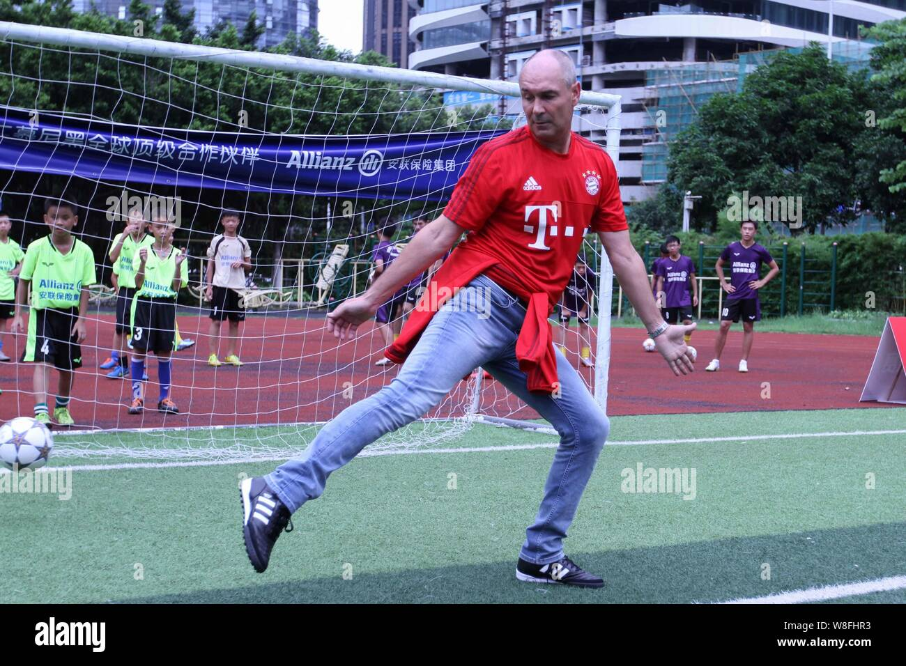 Former German soccer star Raimond Aumann shows his football skill during a fan meeting event in Guangzhou city, south China's Guangdong province, 23 J Stock Photo