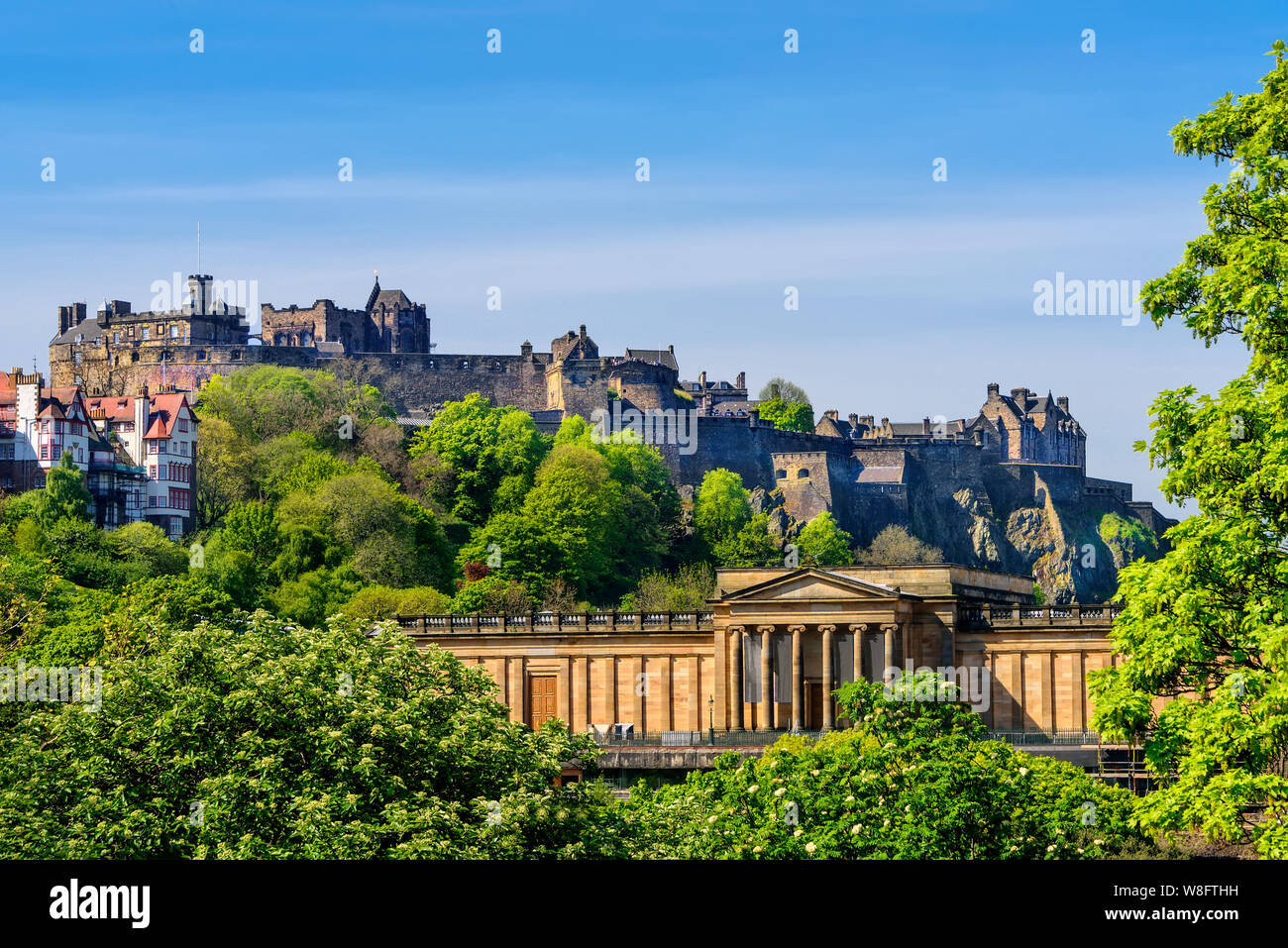 Scenic view of Edinburgh Castle, as it rests on castle rock, and the Scottish National Gallery. Stock Photo