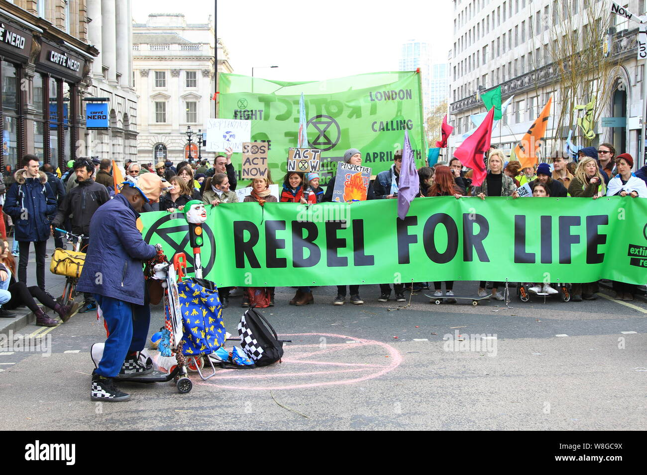 EXTINCTION REBELLION PROTEST BRINGS MUCH OF CENTRAL LONDON TO A HALT. ROAD CLOSURES AS DEPICTED IN THIS PICTURE AT WATERLOO BRIDGE BY A SMALL NUMBER OF PEOPLE HOLDING A REBEL FOR LIFE SIGN. THE TACTIC DESIGNED TO BRING AWARENESS TO HUMAN INDUCED CLIMATE CHANGE. Stock Photo