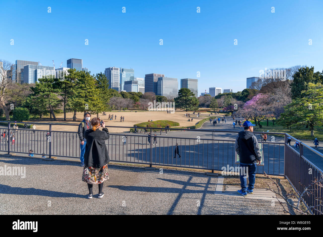 Marunouchi skyscrapers viewed from the Edo Castle Keep with site of Honmaru Goten Palace in foreground, East Gardens, Imperial Palace, Tokyo, Japan Stock Photo