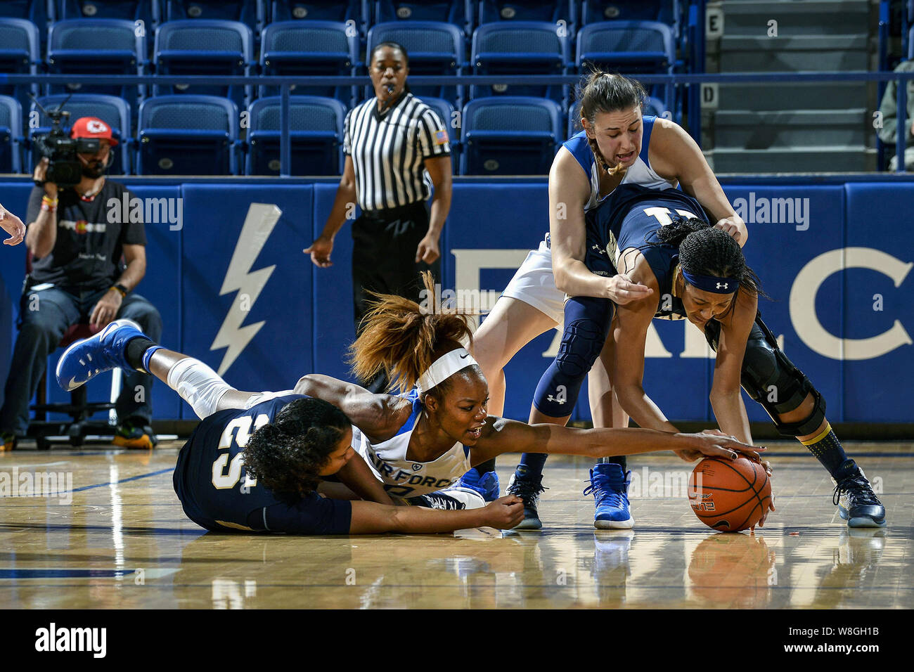 Dee Bennett, a junior, battles for the ball as Air Force hosted Navy at the U.S. Air Force Academy in Colorado Springs, Colo., Nov. 29, 2016. Stock Photo