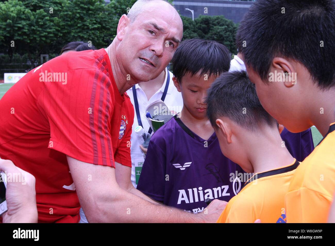 Former German soccer star Raimond Aumann, left, is pictured during a fan meeting event in Guangzhou city, south China's Guangdong province, 23 July 20 Stock Photo