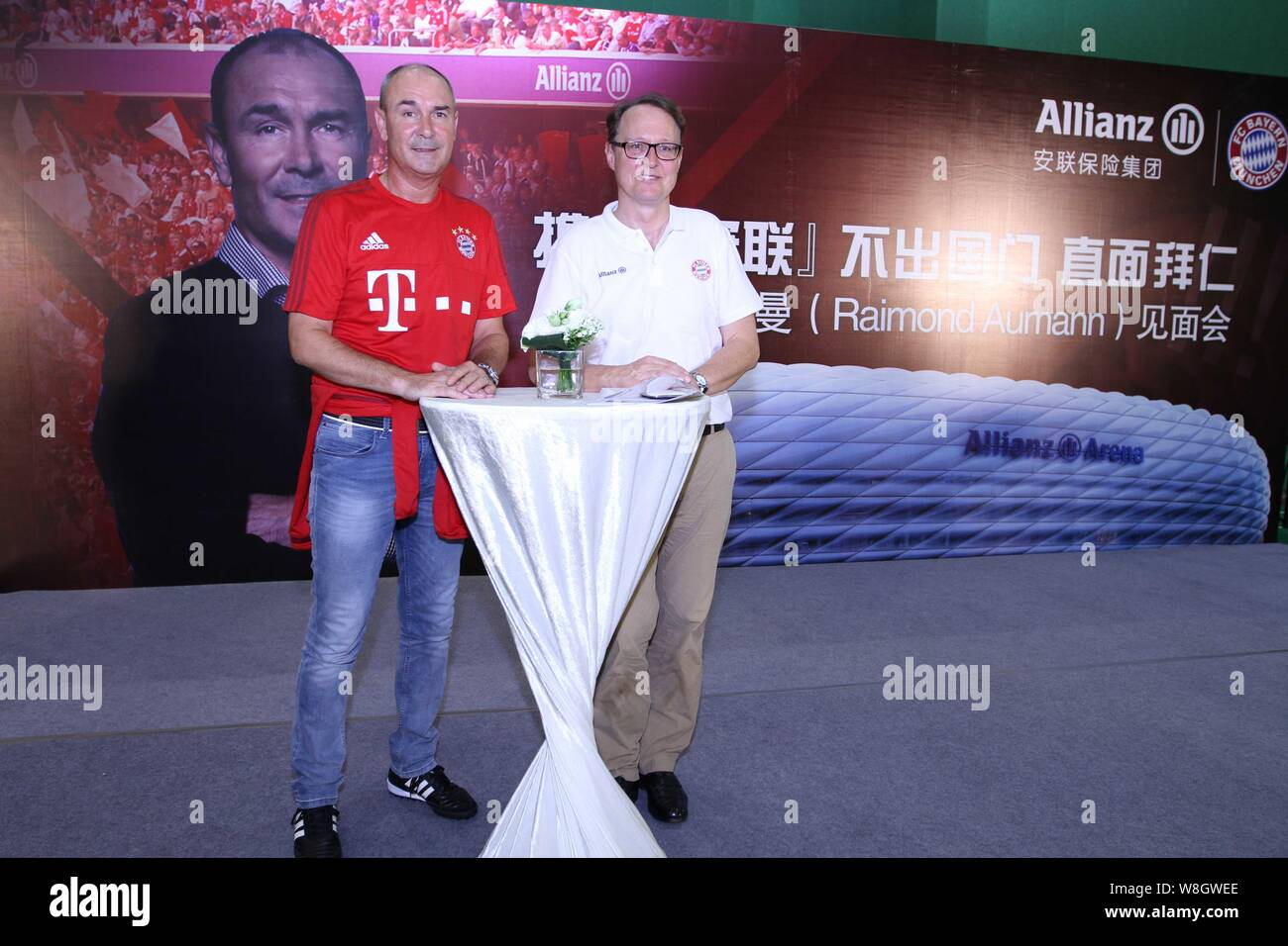 Former German soccer star Raimond Aumann, left, poses during a fan meeting event in Guangzhou city, south China's Guangdong province, 23 July 2015. Stock Photo