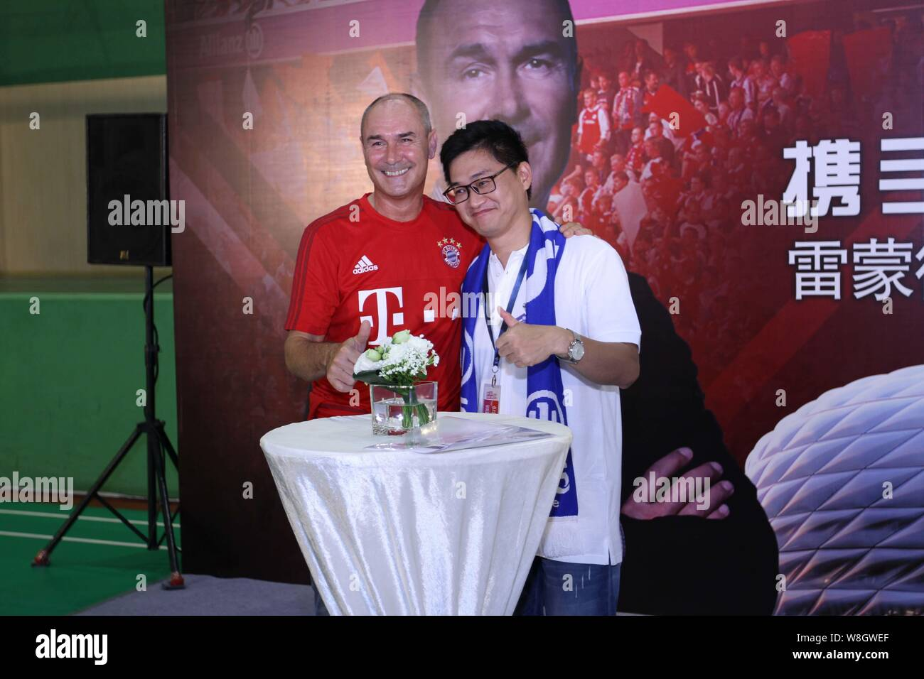 Former German soccer star Raimond Aumann, left, poses with a Chinese fan during a fan meeting event in Guangzhou city, south China's Guangdong provinc Stock Photo