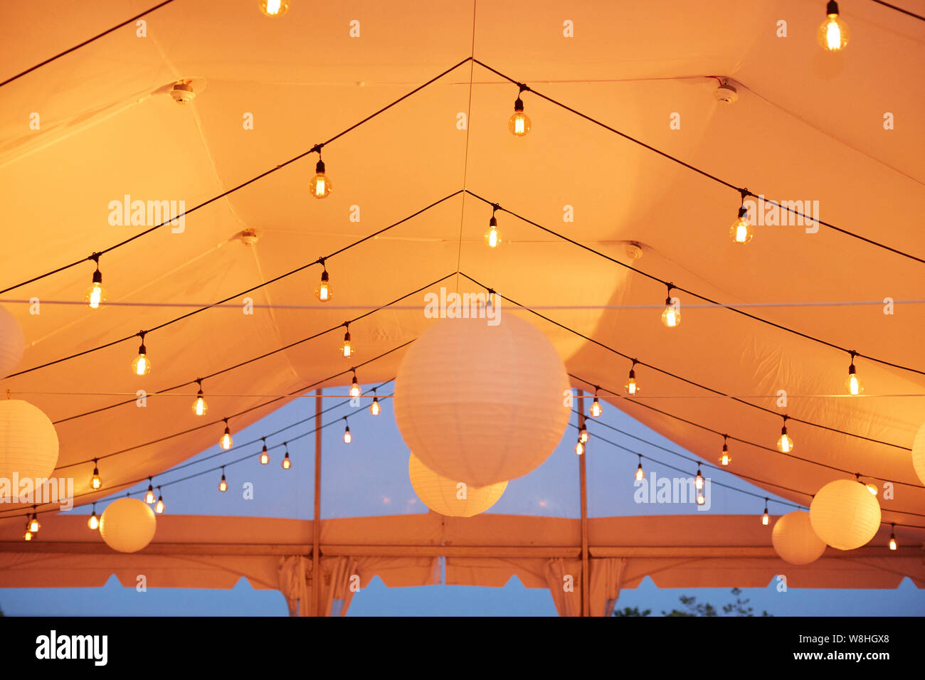 Lights And Paper Lanterns In Wedding Tent Stock Photo Alamy