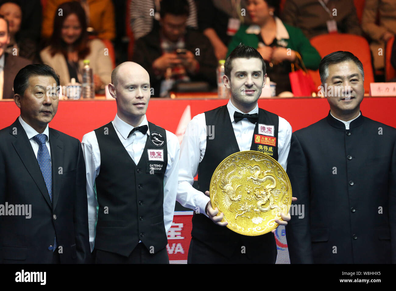Mark Selby of England, second right, poses with his champion ...