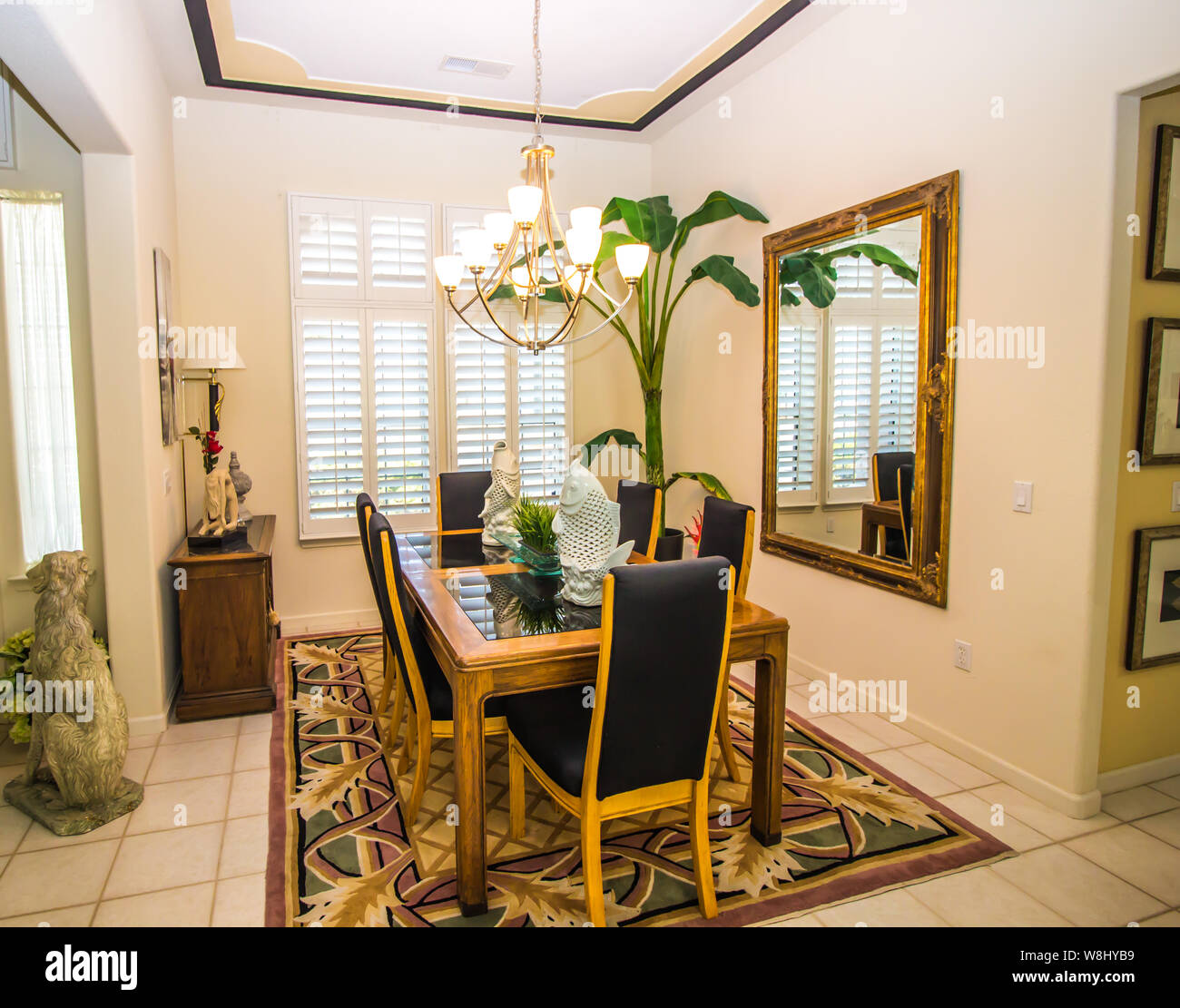 Dining Room With Large Mirror Glass Table And High Back Chairs Stock Photo Alamy