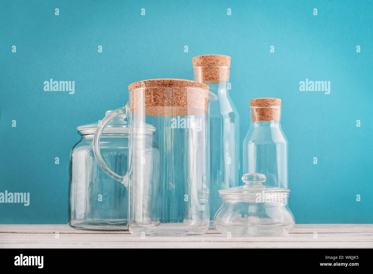 Glass Kitchen Utensils On Blue Background Closeup Stock