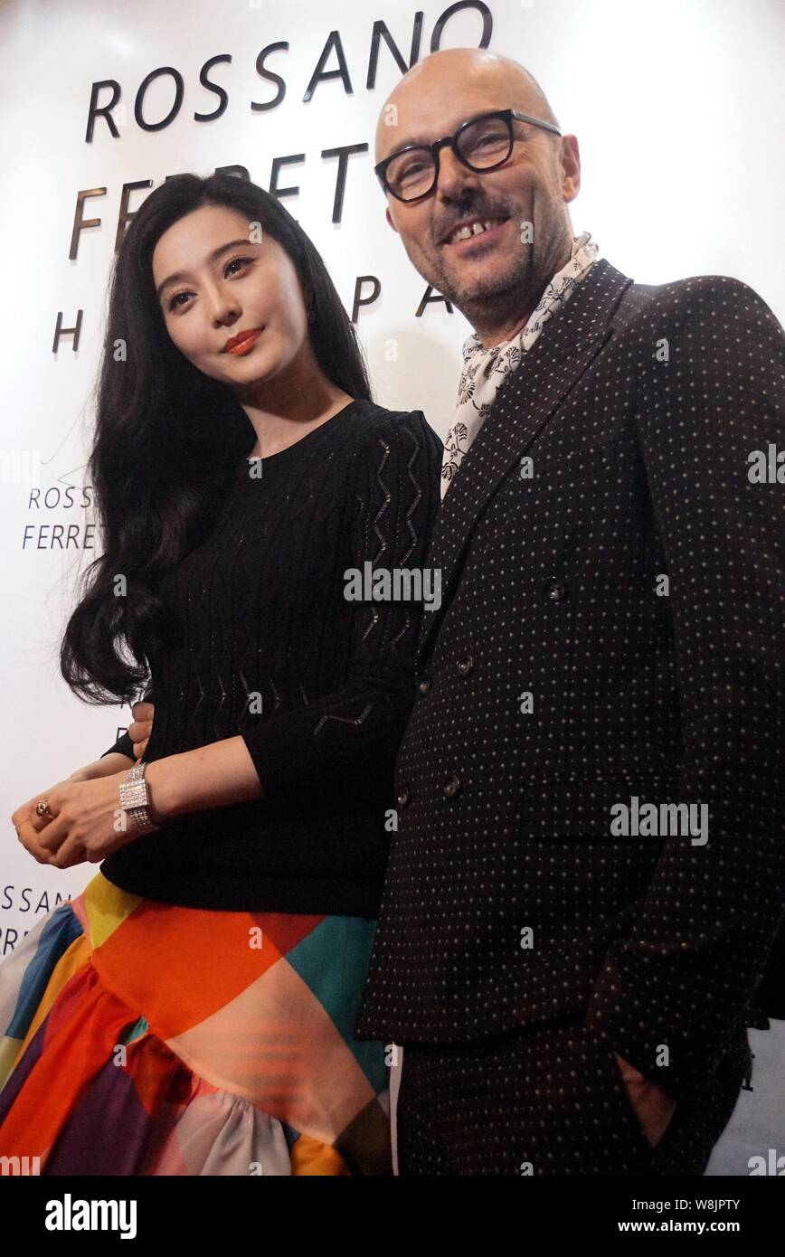 Chinese actress Fan Bingbing (left) poses with executive of Rossano Ferretti during the opening ceremony for a new store of Rossano Ferretti Hair Spa Stock Photo