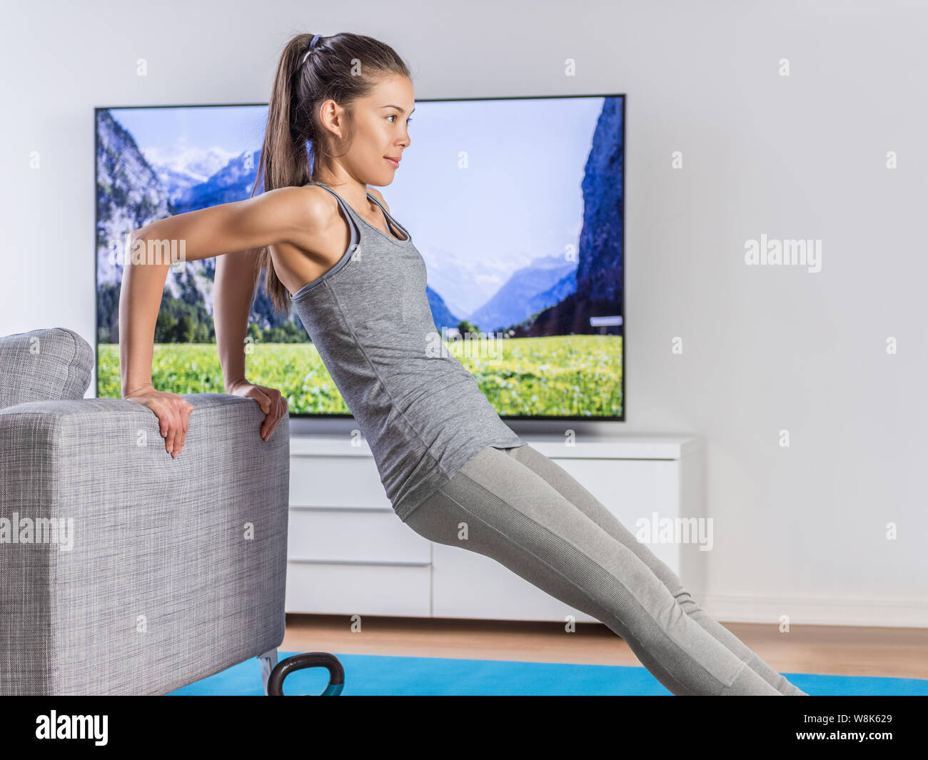 Home Fitness Woman Strength Training Arms Watching Online Tv