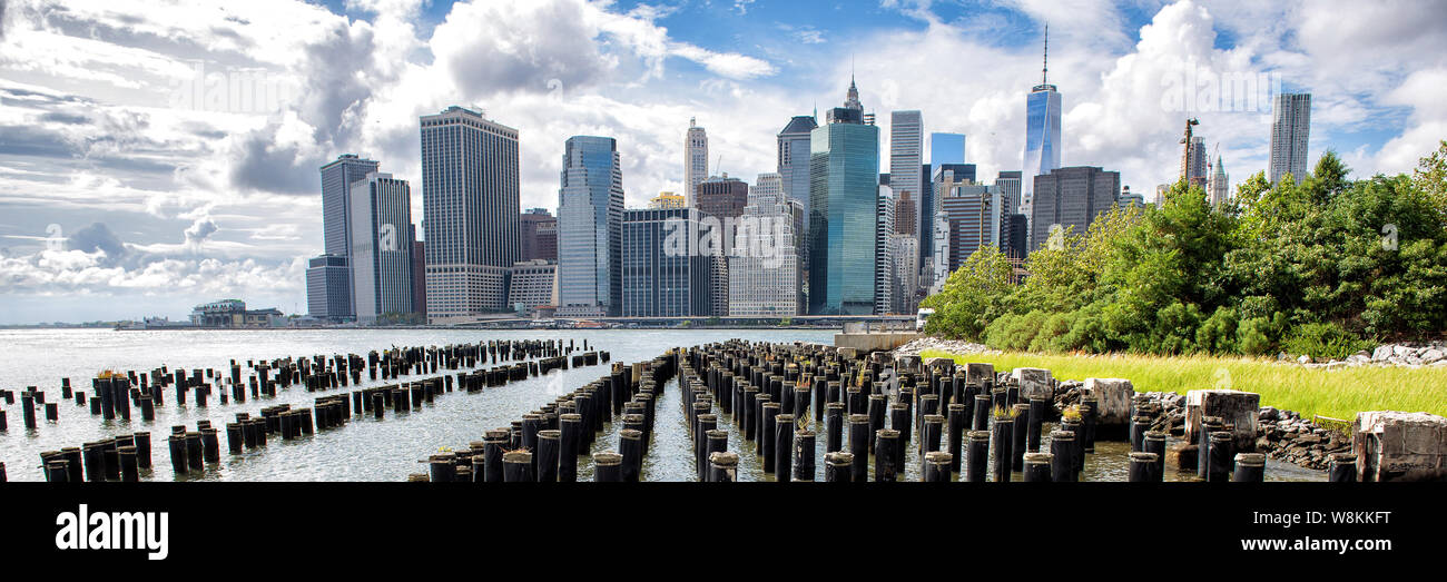 New York City Nyc Manhattan Island Skyline Panorama Scenic View Banner Crop Of Waterfront Lifestyle For Advertisement Copyspace Downtown Cityscape From The Brooklyn Bridge Park Pier 1 Salt Marsh Stock Photo Alamy