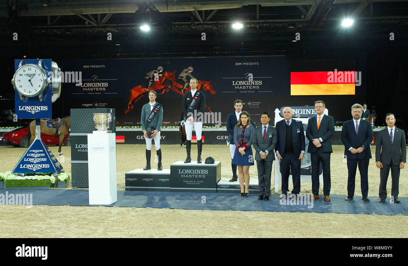 Macro Kutscher of Germany, top, Hong Kong singer and actor Aaron Kowk, front second left, and other riders and guests attend the award ceremony for th Stock Photo