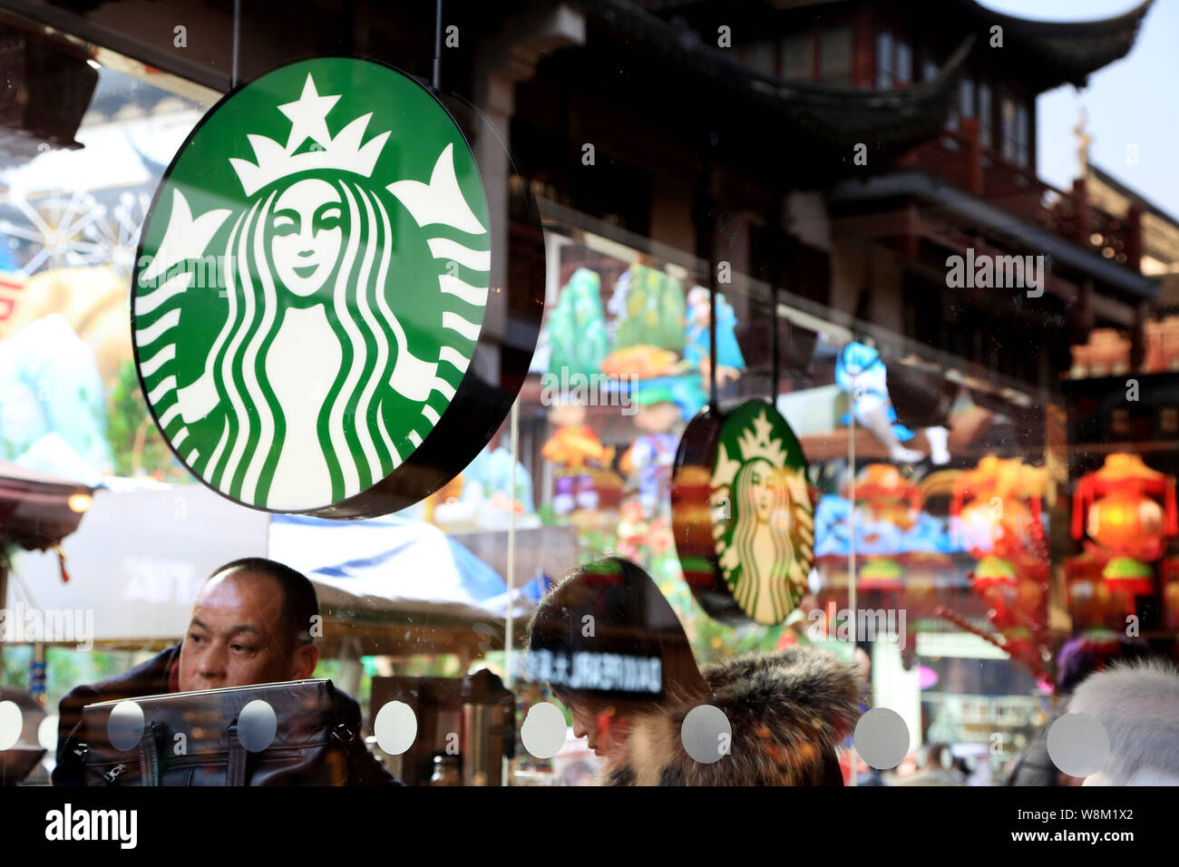 File Chinese Customers Enjoy Coffee In The Cafe Of Starbucks