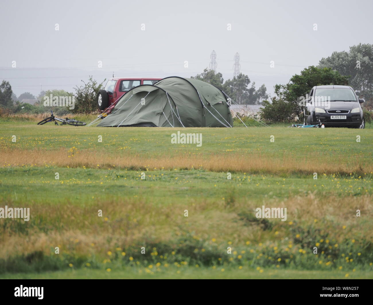 Sheerness, Kent, UK. 10th August, 2019. UK Weather: campers contend with high wind speeds and bad weather in Sheerness, Kent today. Credit: James Bell/Alamy Live News Stock Photo