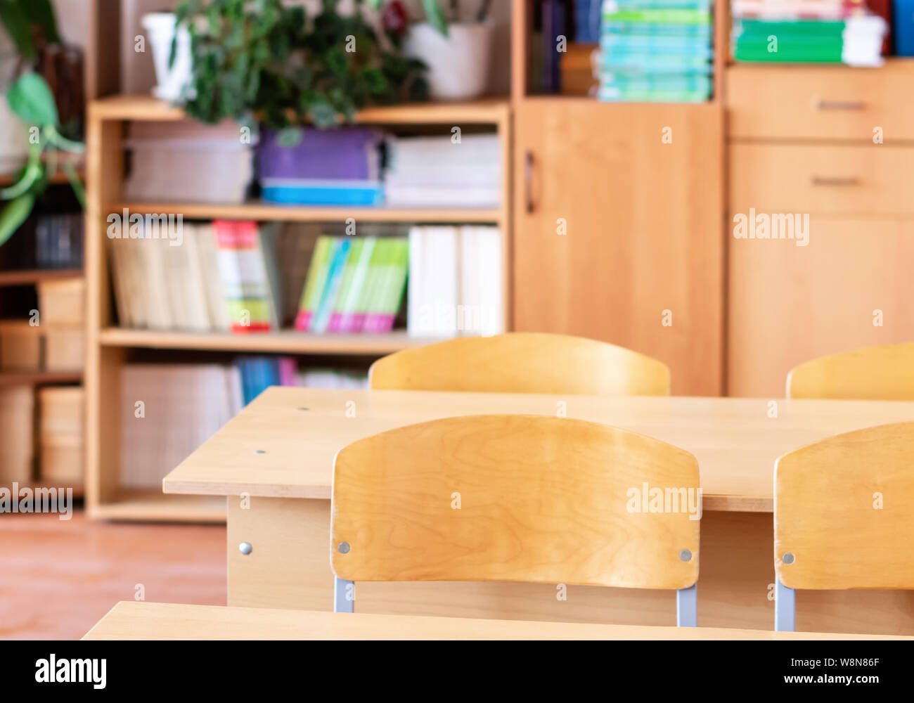 School desk against the background of school furniture in an ...