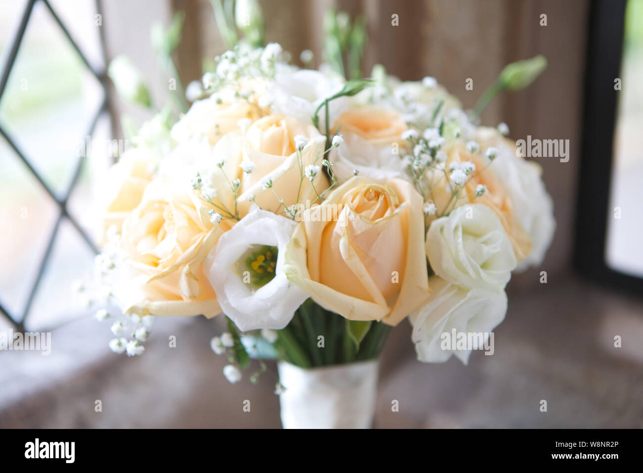 Hand Tied Wedding Bouquets In White Peach Stock Photo Alamy