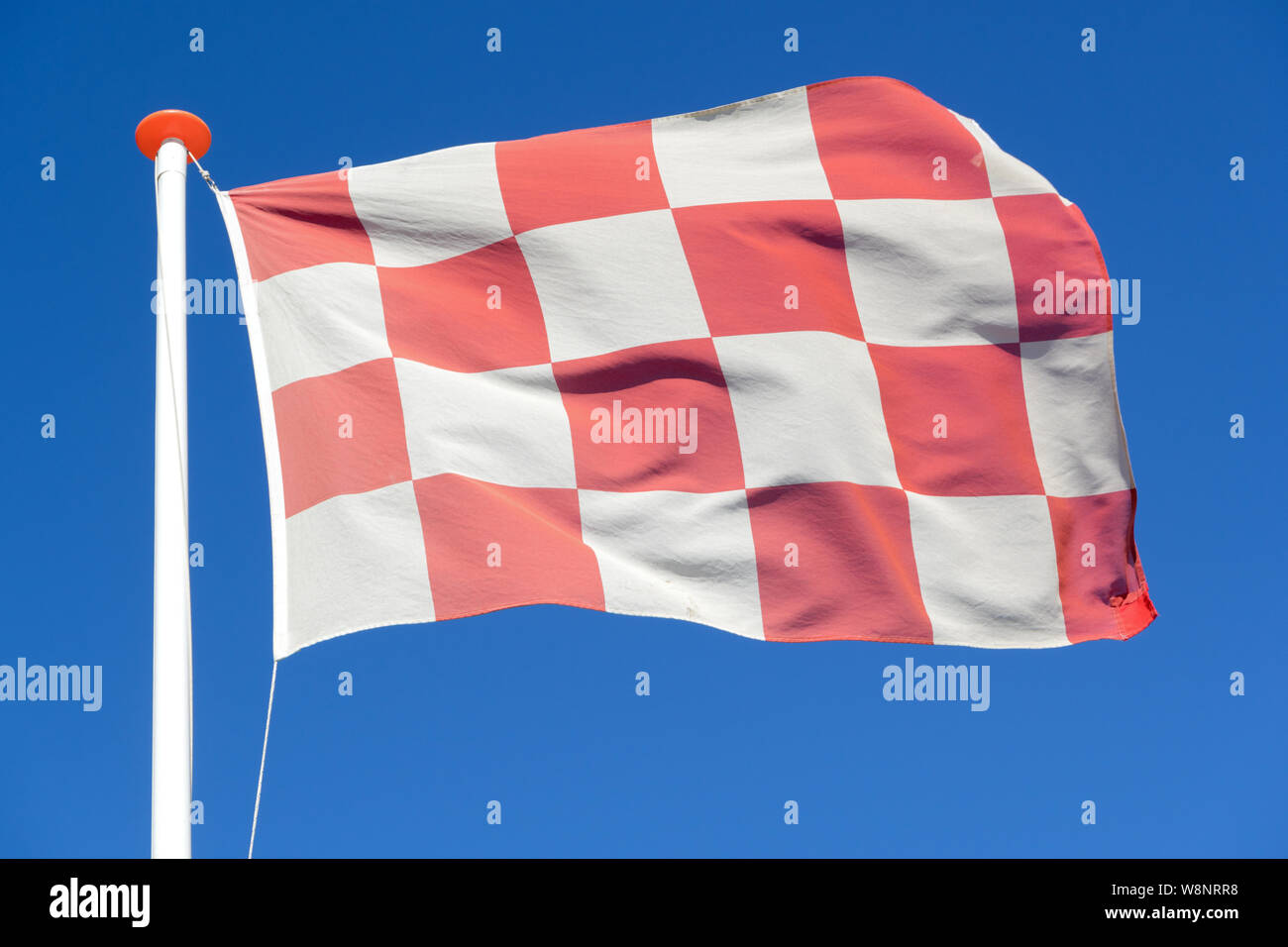 flag of Dutch province North Brabant flying in the wind Stock Photo