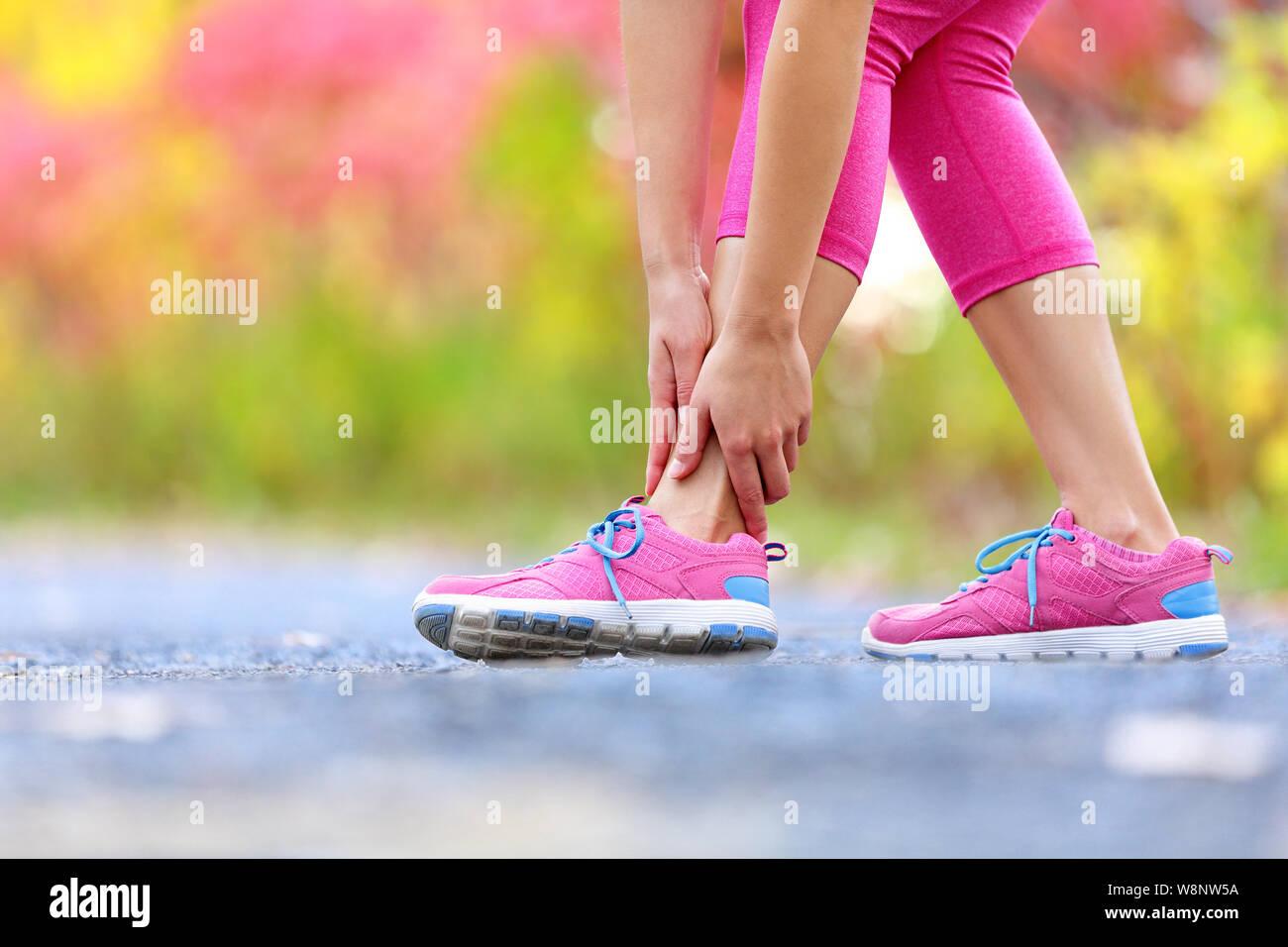 Running sport injury - twisted broken ankle  Female athlete