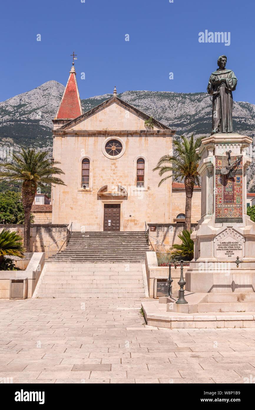 Church and statue at Makarska on the Adriatic coast of Croatia Stock Photo