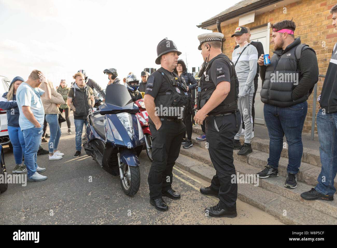 Southend on Sea, UK. 10th Aug, 2019. Police seize a motorcycle for illegal number plate. Friends and family of Cian Daly, one of five people who passed away at the end of July in suspected drugs-related deaths in South Essex, meet for a memorial ride on Southend seafront before heading to Leigh on Sea for a balloon release. Penelope Barritt/Alamy Live News Stock Photo