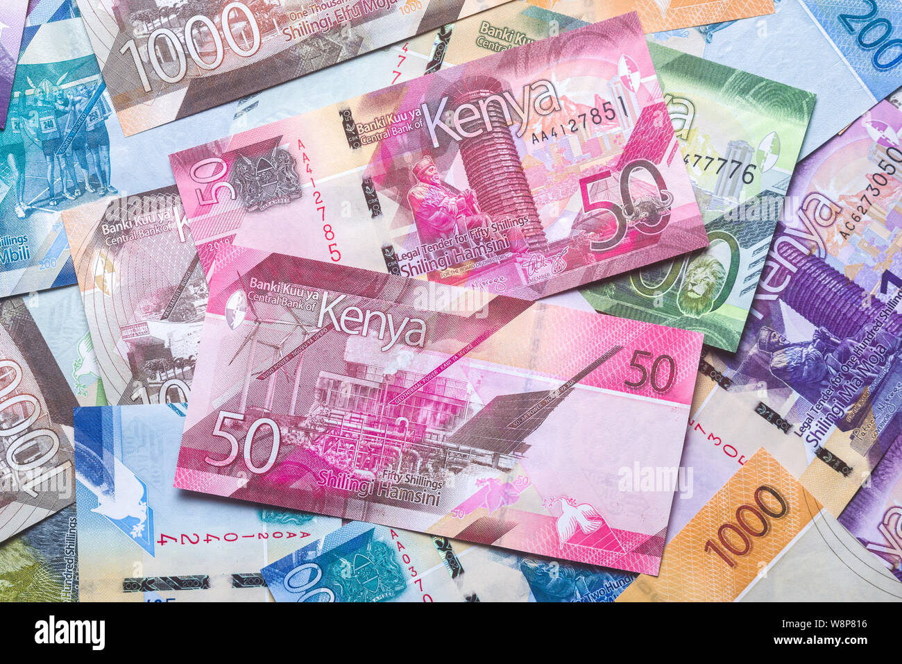 New 2019 Kenyan 50 Shilling bank notes on top of other bank notes in various denominations Stock Photo