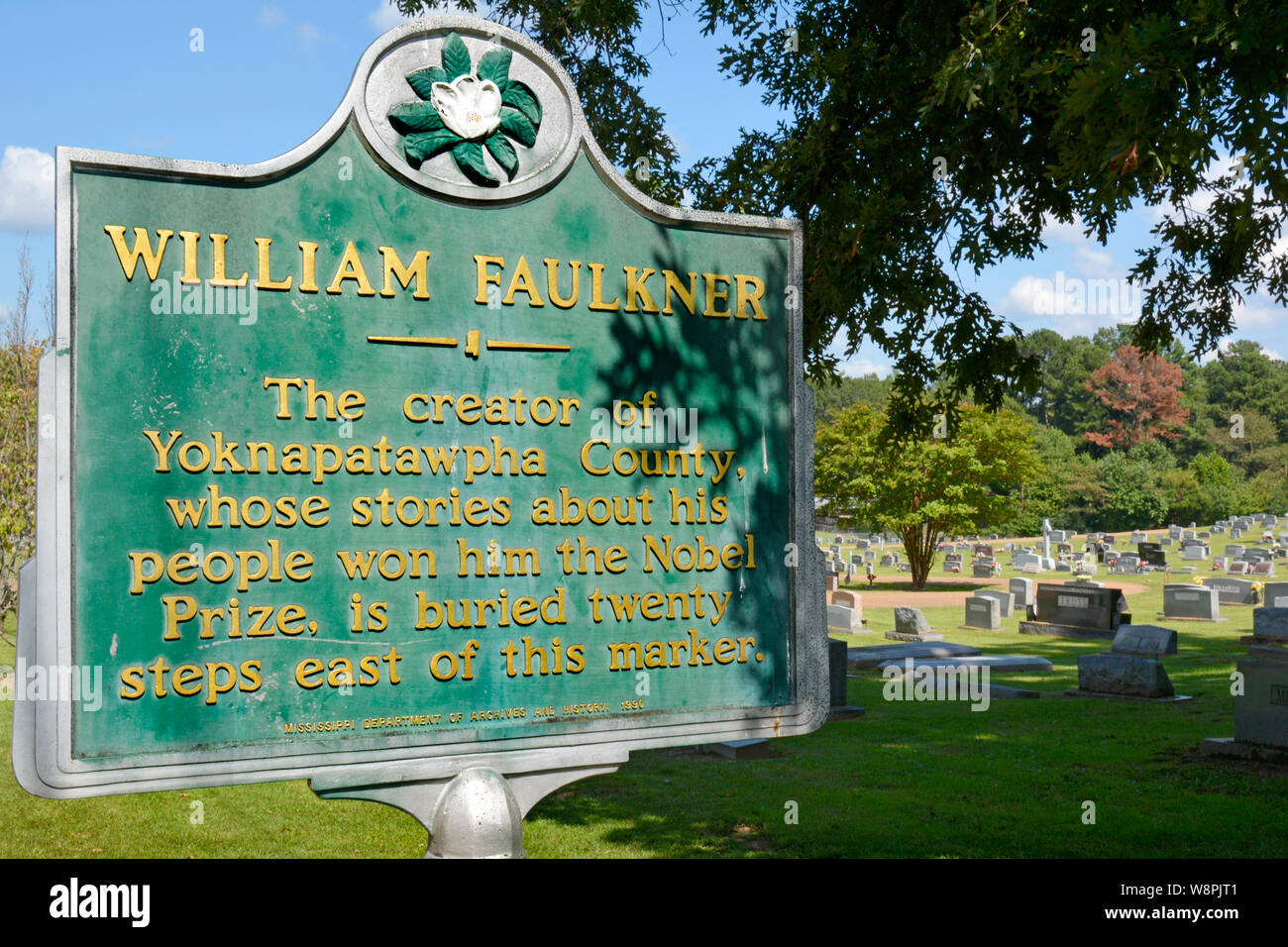 A historic marker noting the nearby burial site of Nobel Prize Laureate, William Faulkner, in his hometown of Oxford, MS Stock Photo