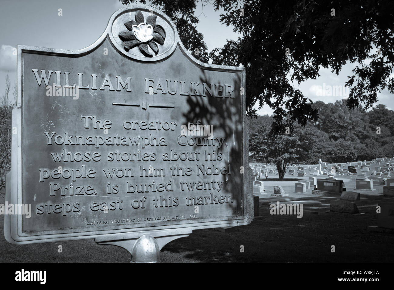 A historic marker noting the nearby burial site of Nobel Prize Laureate, William Faulkner, in his hometown of Oxford, MS, in selenium tone Stock Photo