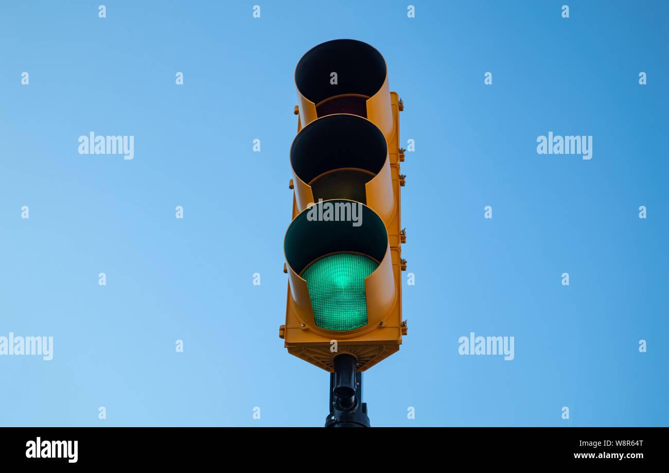 Go sign. Green traffic light for cars, blue sky background Stock Photo