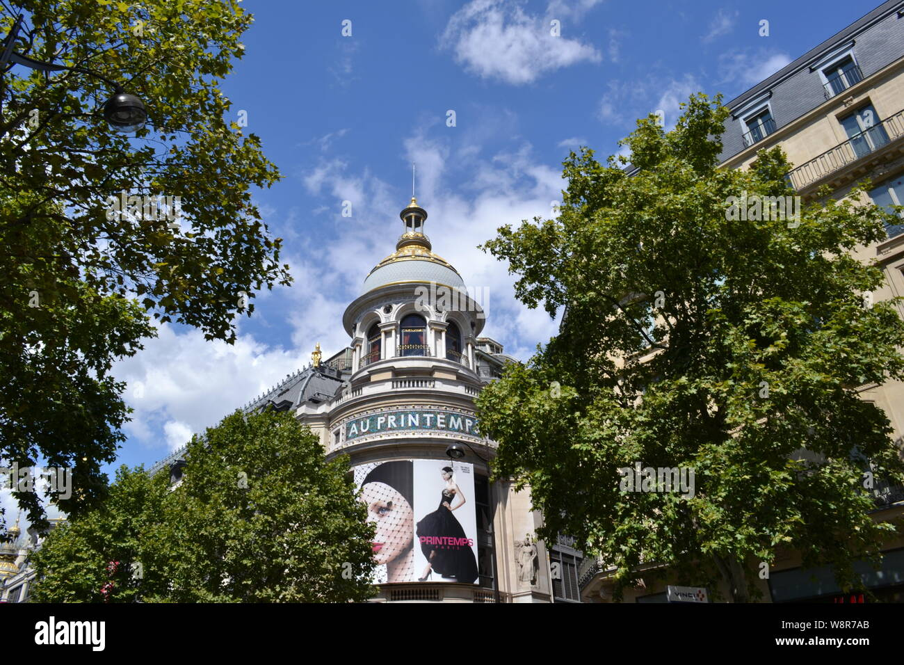 Paris/France - August 19, 2014: Beautiful women photos on the facade of the famous Au Printemps department store for beauty biggest in the world. Stock Photo