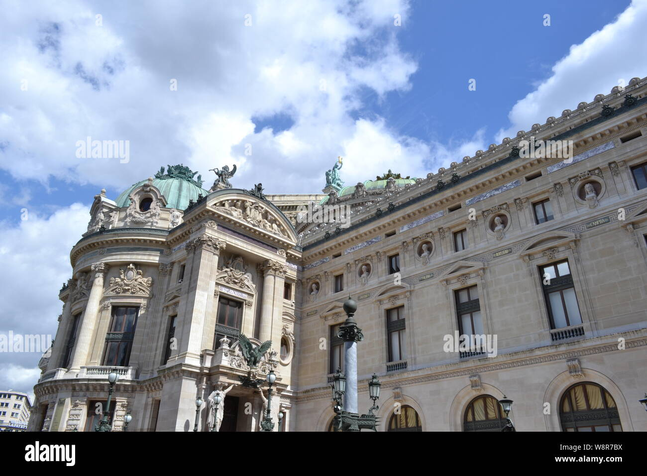 Paris/France - August 19, 2014: Facade of the Opera de Paris and National Academy of music with bronze statues on the roof in a sunny weather. Stock Photo