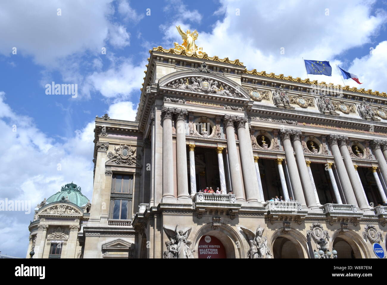 Paris/France - August 19, 2014: Facade of the Opera de Paris and National Academy of music with golden statues on the roof in a sunny weather under th Stock Photo